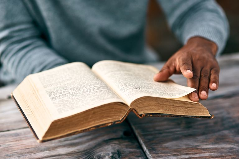 man reading bible verses