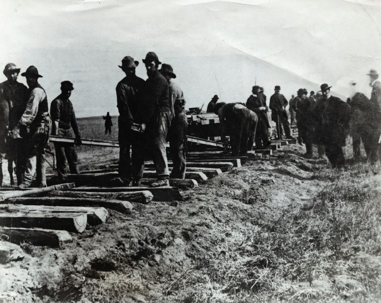 Men Laying Railroad Tracks