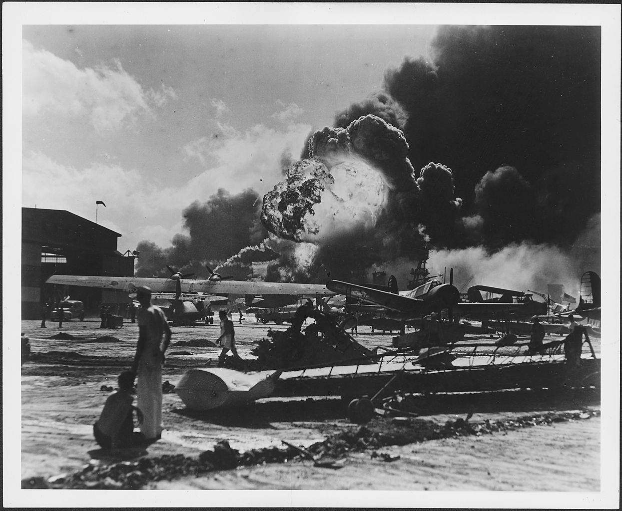 Photograph of the wreckage-strewn Naval Air Station at Pearl Harbor following the Japanese attack.