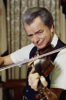 Senator Robert Byrd of West Virginia playing a fiddle