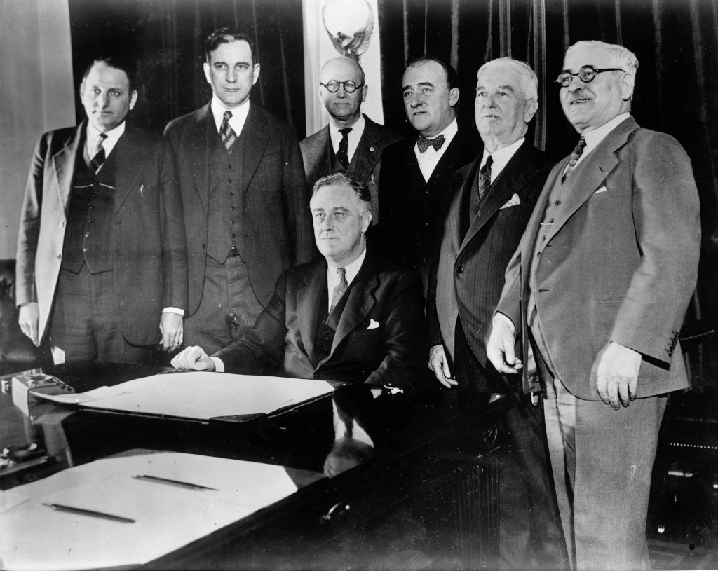 Members of Congress posing with Franklin D Roosevelt at the signing of the Cullen-Harrison Act