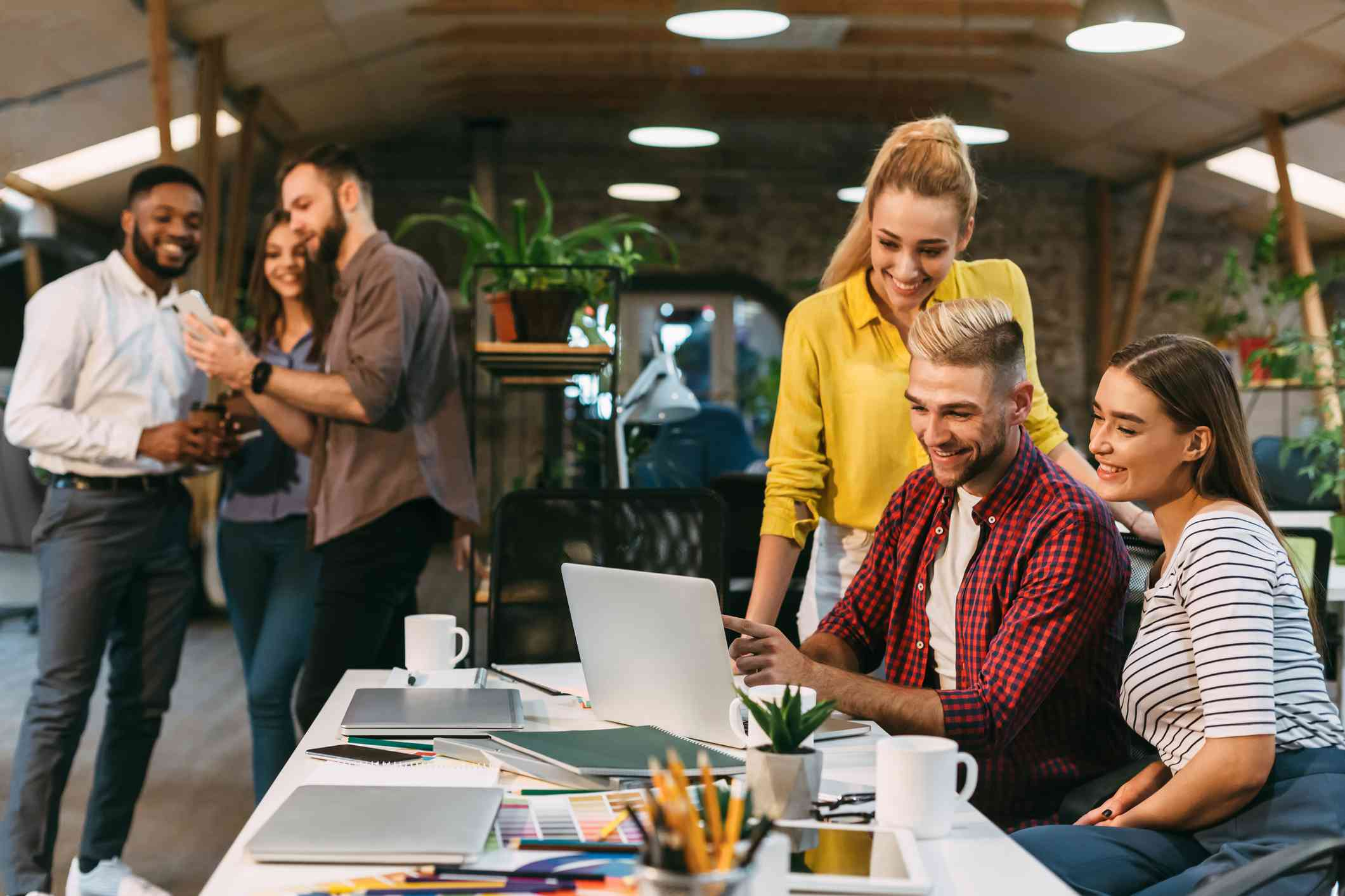 Young web designers working together at modern office