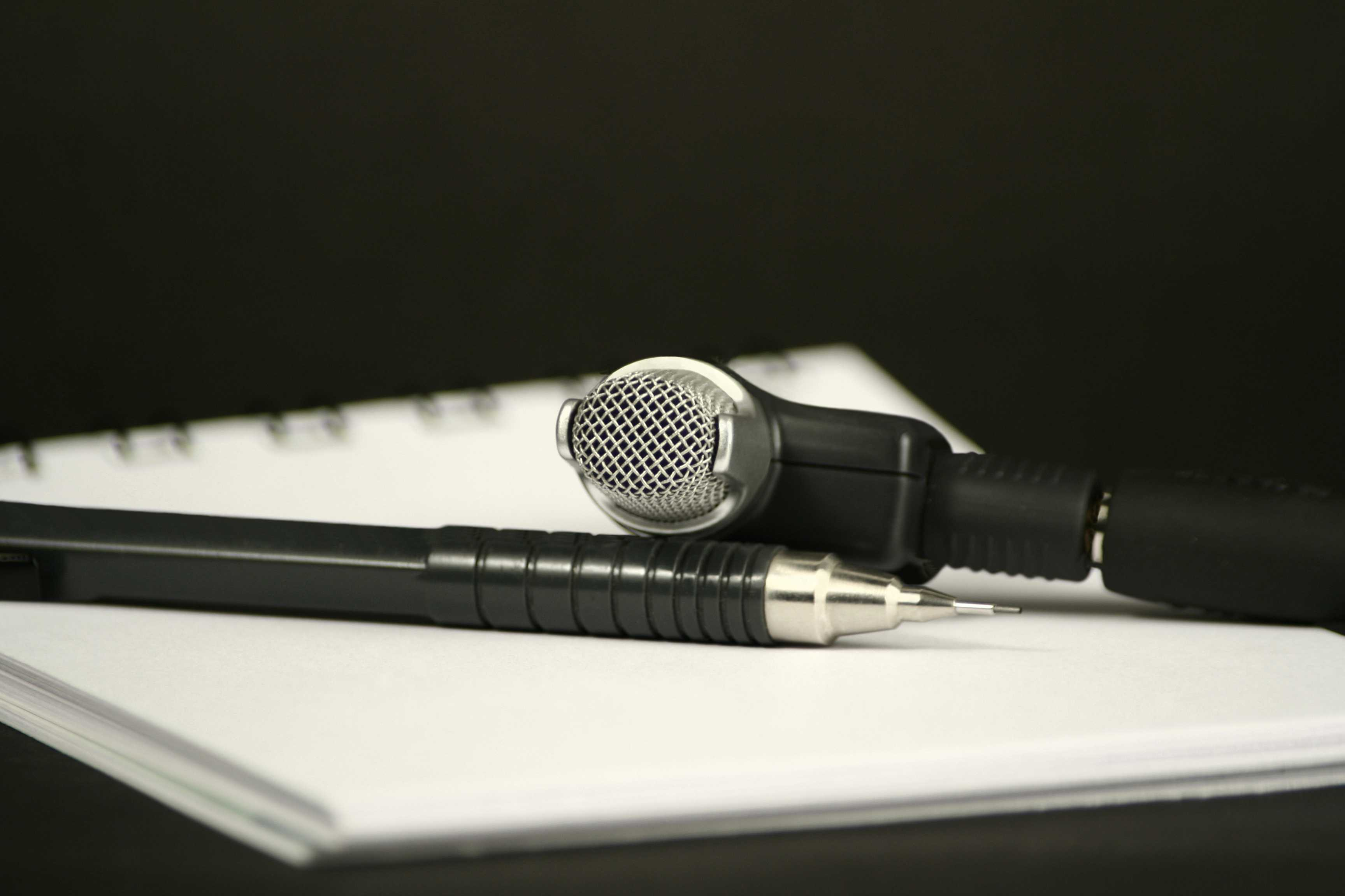 microphone, pencil and note pad