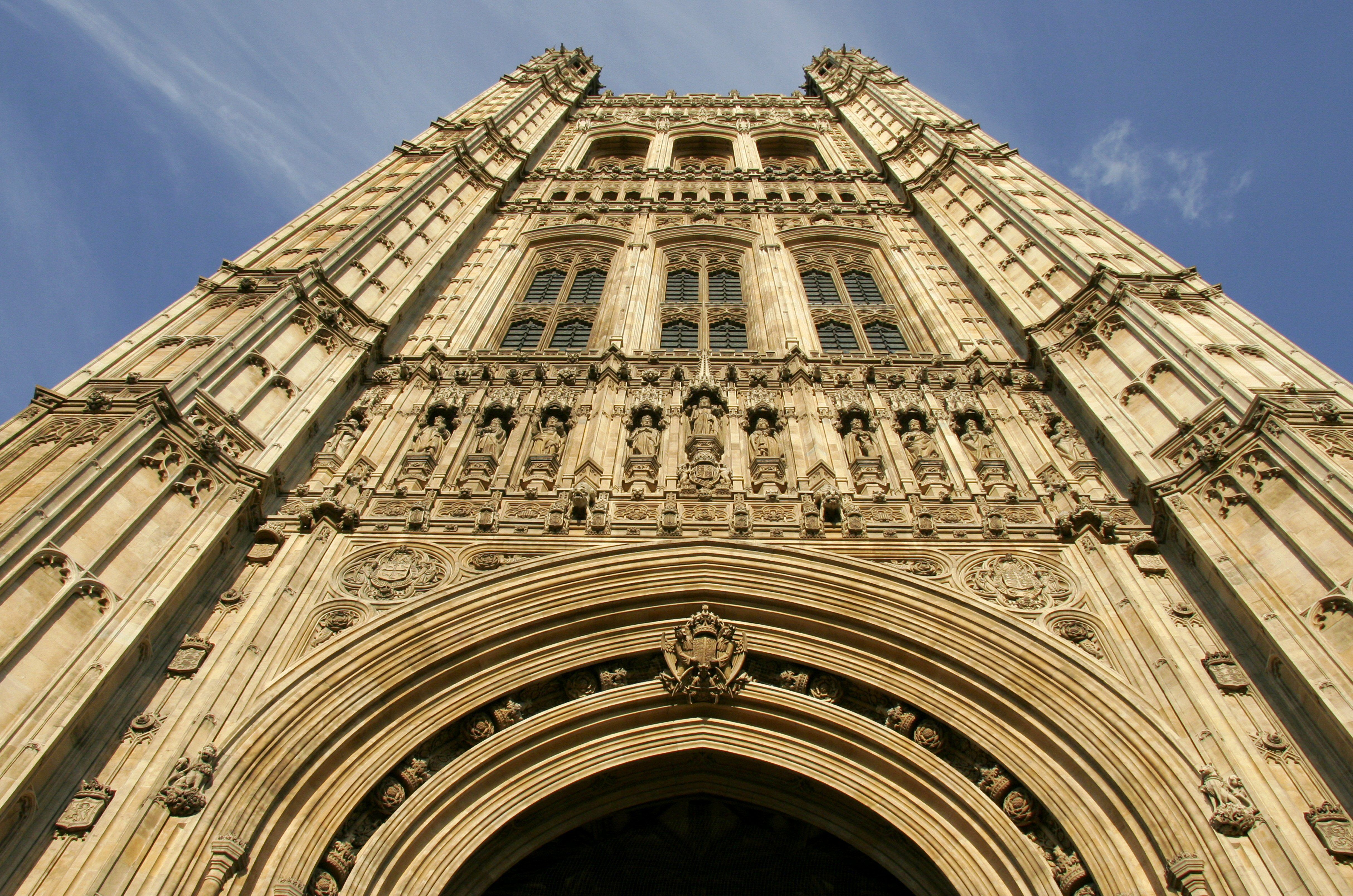 Looking up the High Victorian Gothic Victoria Tower (1860) in London, The Houses of Parliament