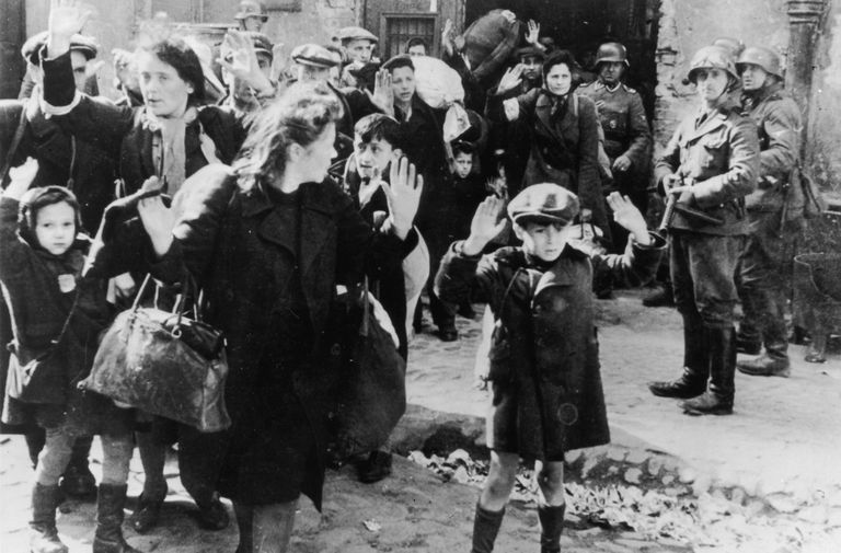 Jewish people from the Warsaw ghetto surrender to German soldiers after the uprising.