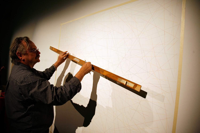 John Hogan creating a Sol Lewitt line drawing