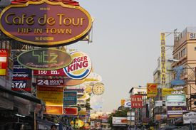 numerous business signs lining the street demonstrating market competition