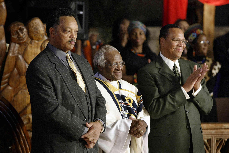 Rev. Jesse Jackson, Archbishop Desmond Tutu, and Minister Louis Farrakhan standing together