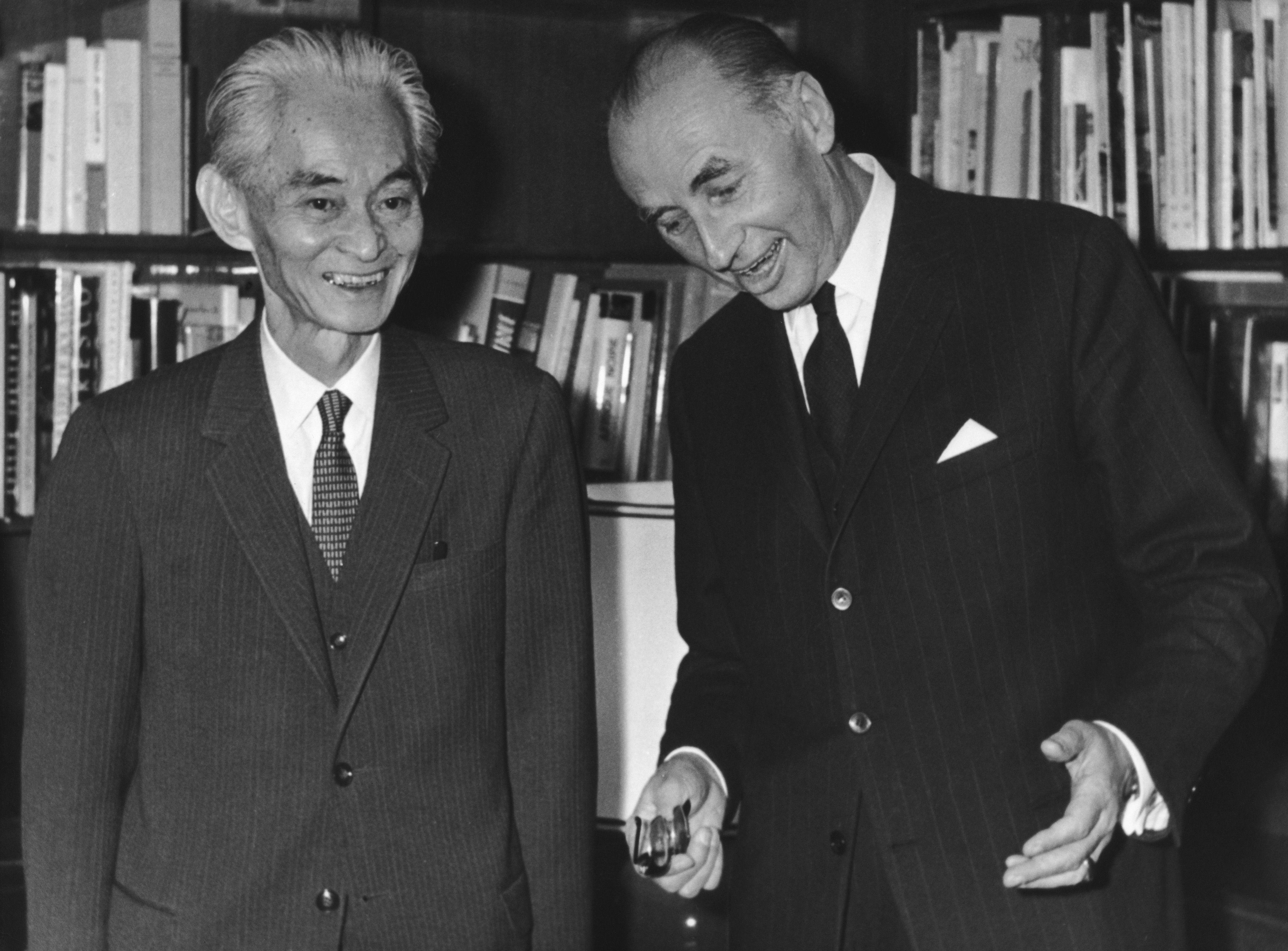 Rene Maheu (1905 - 1975, right), Director-General of UNESCO, welcomes Japanese author Yasunari Kawabata (1899 - 1972), winner of that year's Nobel Prize for Literature, to Paris, 18th December 1968