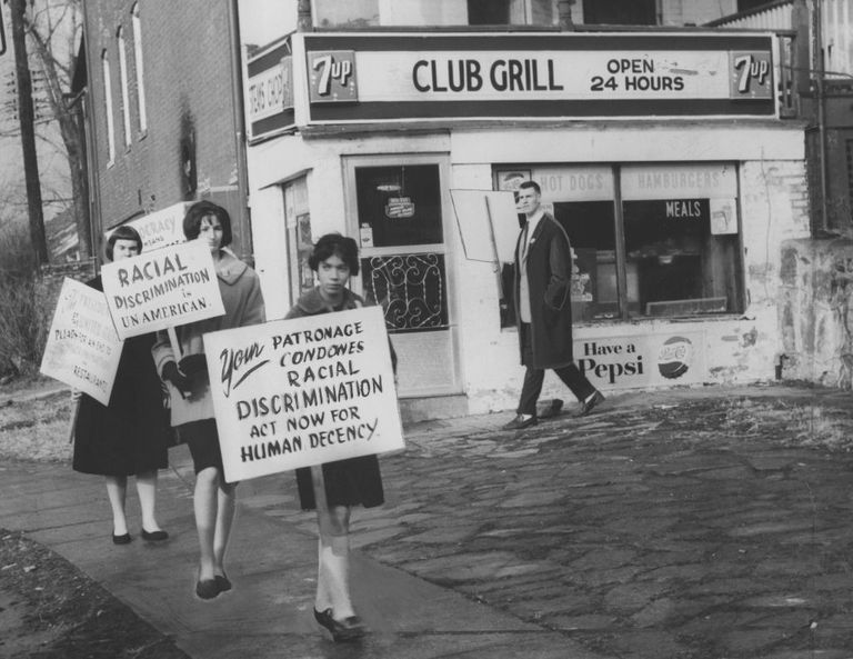Members of the Congress of Racial Equality picket outside of a diner that denies lunch service to blacks.
