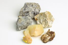 Pieces of calcite, blue aragonite, opal, sodalite