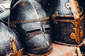 row of knights' helmets