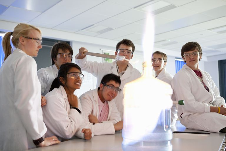 Students conducting the fire in a bottle experiment