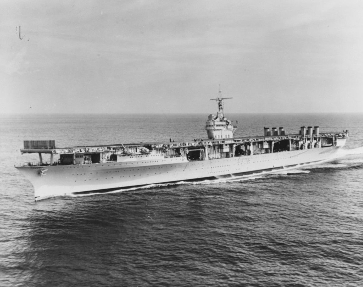 Aircraft carrier USS Ranger at sea with empty flight deck.