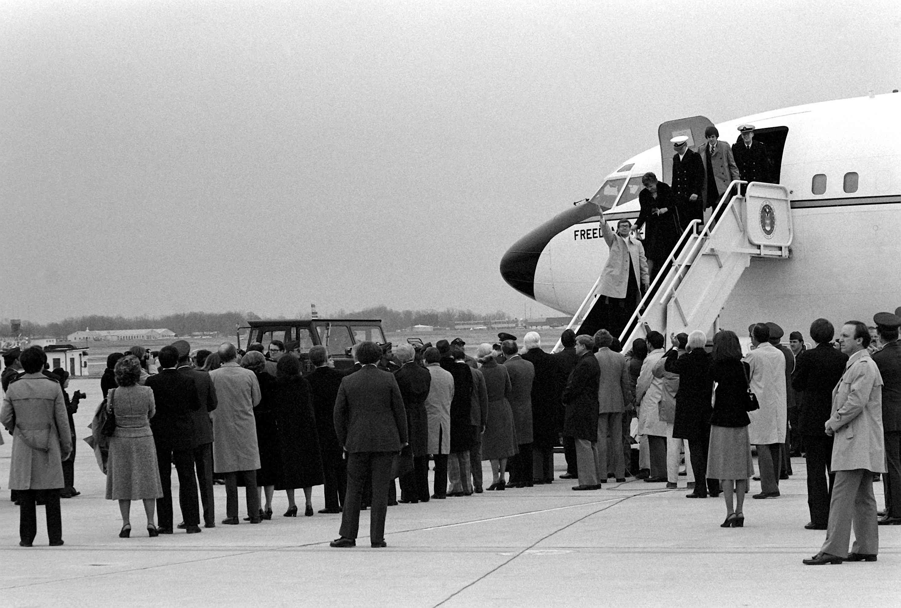 Freed Americans hostages disembark Freedom One, an Air Force VC-137 Stratoliner aircraft, upon their arrival at the base, January 27, 1981