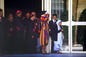 Mother Teresa waits at the Vatican to greet Pope John Paul II