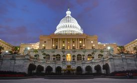 The U.S. Capitol building light up dramatically at twilight