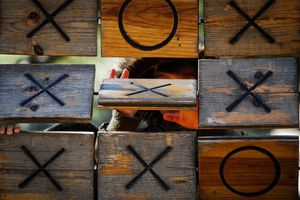 Children playing tic tac toe on a playground