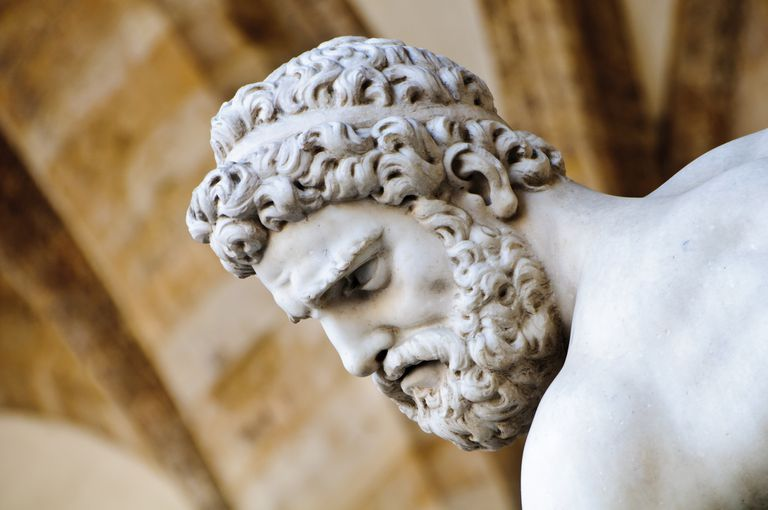 Head detail of stone sculpture of Hercules