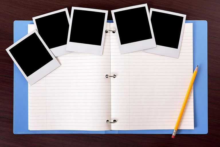 Blue ring binder with photos and writing paper