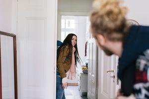 Couple leaving apartment