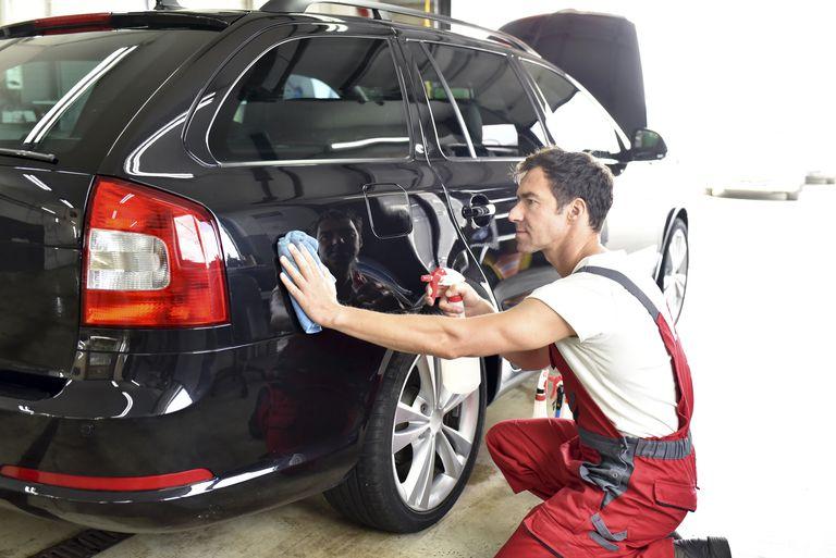 Car cleaning, man polishing car