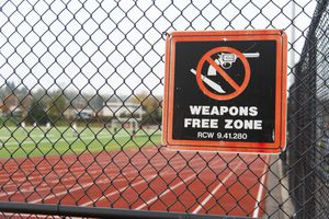 Weapons Free Zone sign at school field