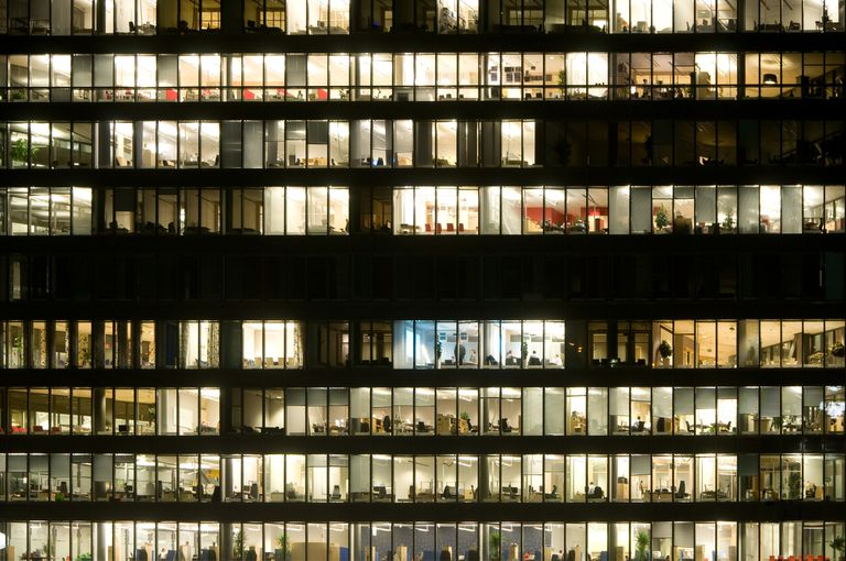 Cross section of an office building with people working late
