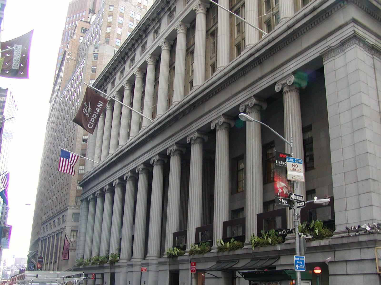 Photo of the 55 Wall Street building with its rows of columns.
