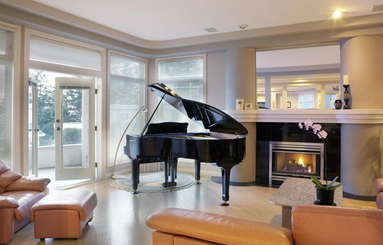 Piano beside fireplace in living room