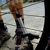Pumping up a bike tire.