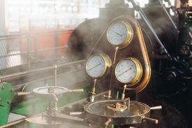 Industrial machinery with temperature and pressure gauges.