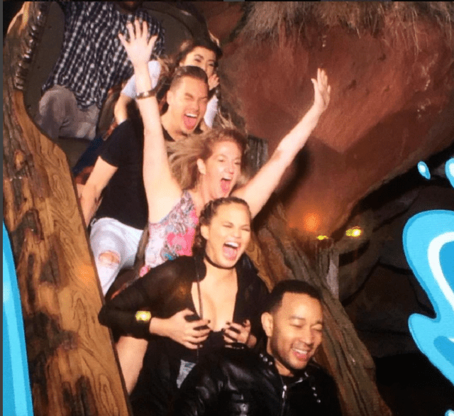 Chrissy Tegan and John Legend on a roller coaster