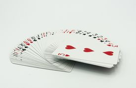Close-Up Of Deck of Cards On White Background.