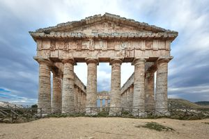 Front view of majestic Doric temple of Segesta against gramatic sky in Sicily, Italy