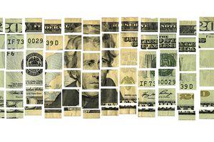 US twenty dollar bill in pieces
