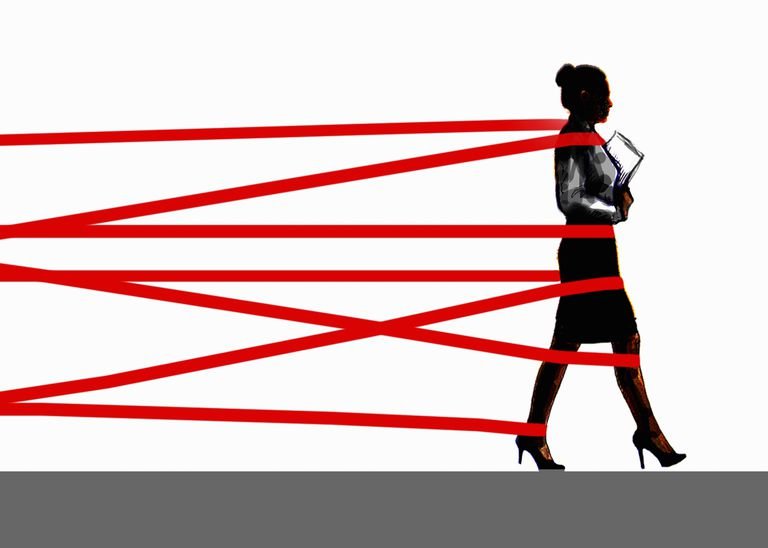 Graphic rendering of a businesswoman being held back by red tape.