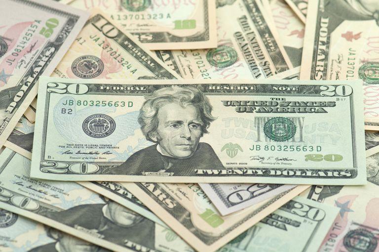 Pile of new series American money twenty on top.