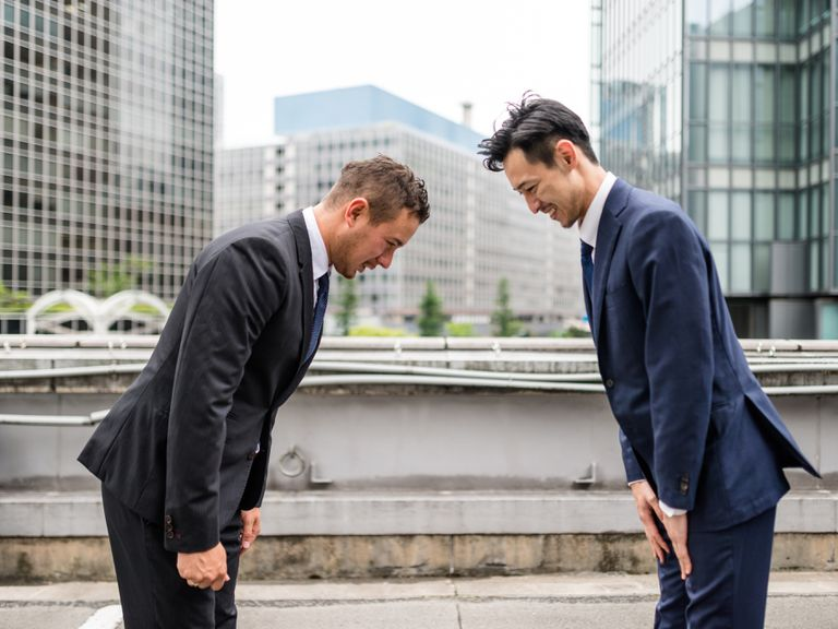 Japanese business persons greeting each other