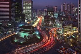 Traffic in downtown Seoul at night.