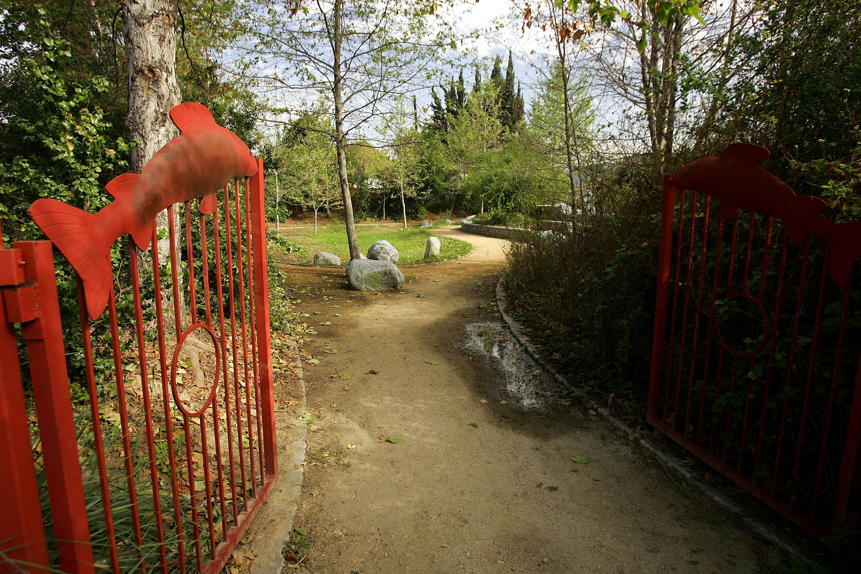 Red Gates Open to Hiking Path in a city park