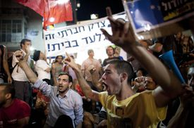 Thousands of people march in the streets during a protest against the rising cost of living on August 6, 2011 in Tel Aviv, Israel.