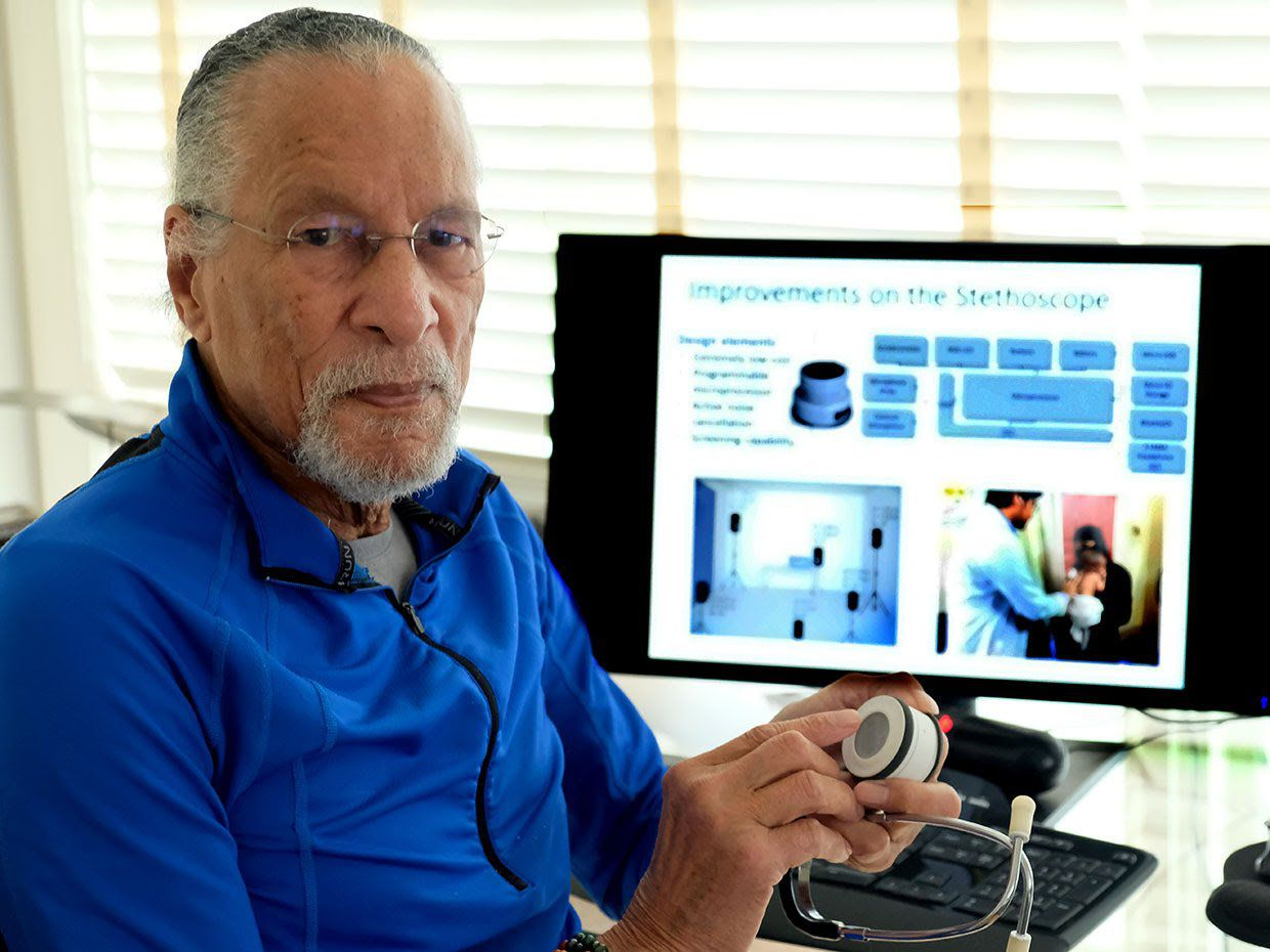 Johns Hopkins School of Engineering Professor Dr. James Edward Maceo West featured with a prototype of his research group's latest invention, a smart digital stethoscope with artificial intelligence algorithms.