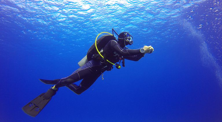 A scuba diver near the surface.