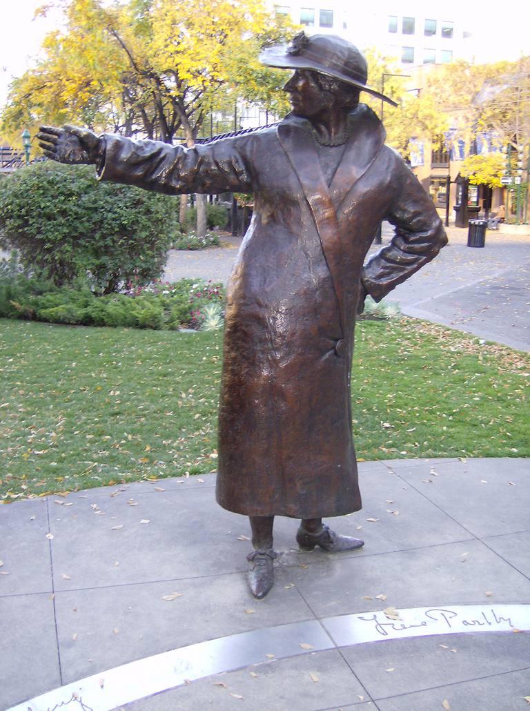 metal statue of woman gesturing