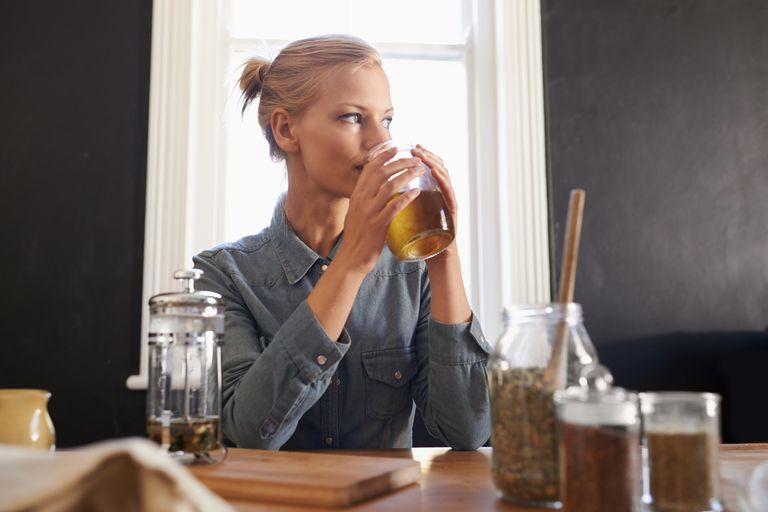 Woman sitting at table in thought