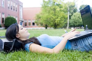 High school student on her laptop.
