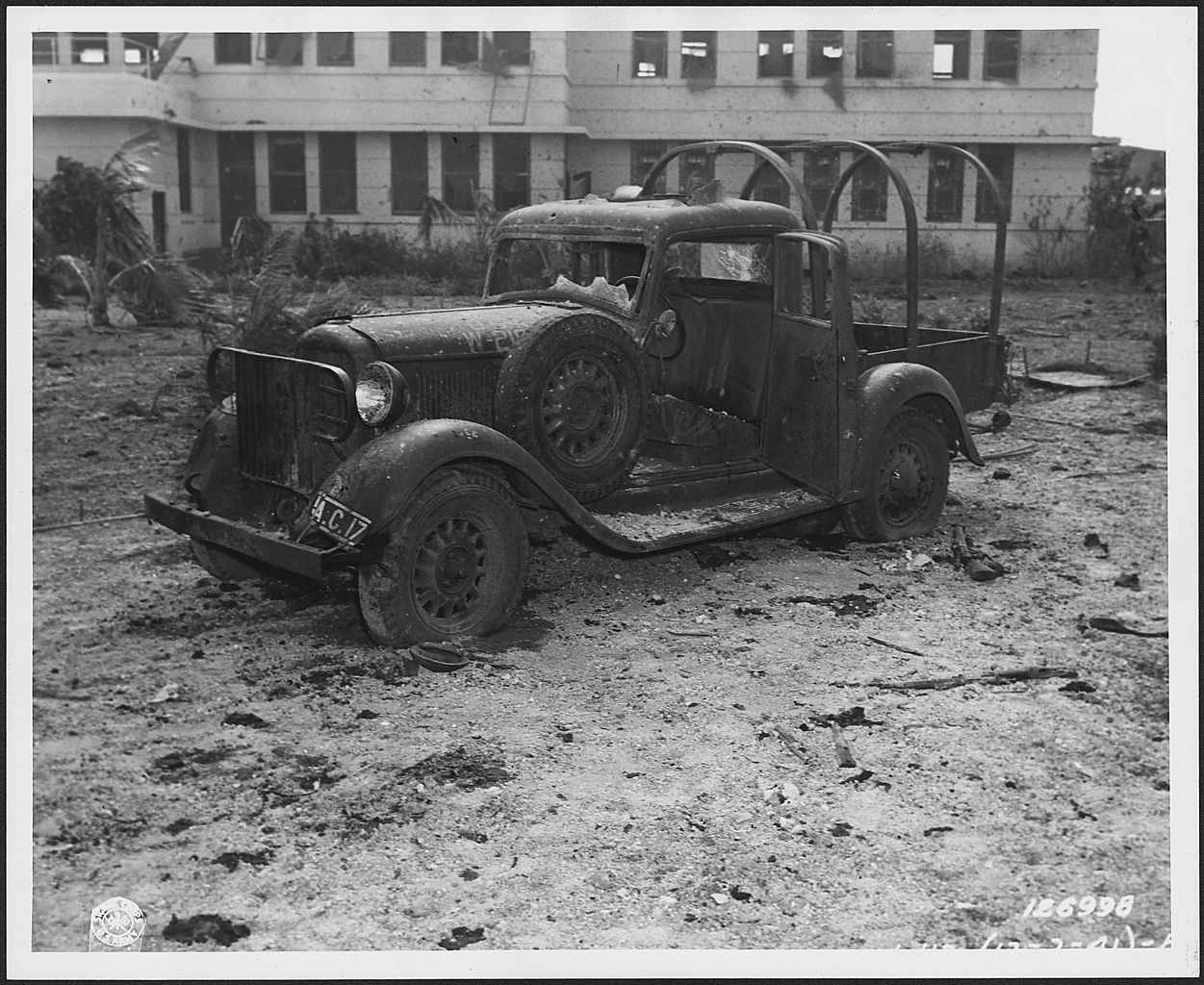 Photograph of a machine-gunned army truck at Hickam Field, Hawaii, after the attack on Pearl Harbor.