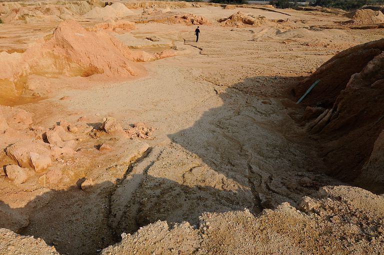 A labourer works at the site of a rare earth metals mine at Nancheng county