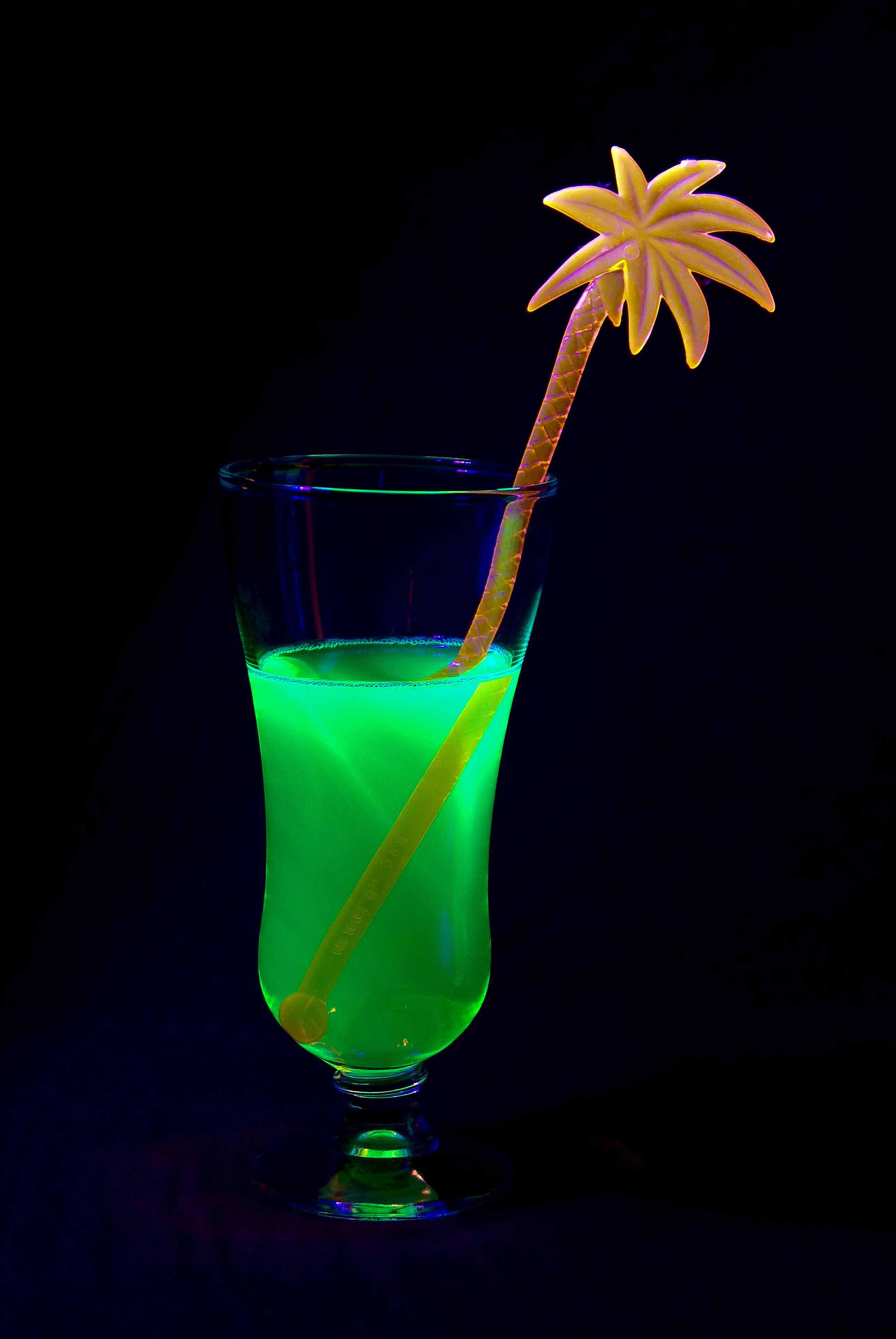 Very few liquids you can safely drink glow in the dark, but some do glow under black light.